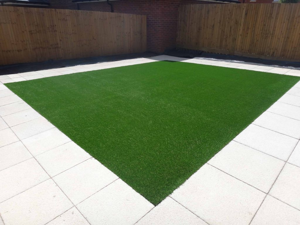 Square of Artificial Grass installed by Acre Driveways