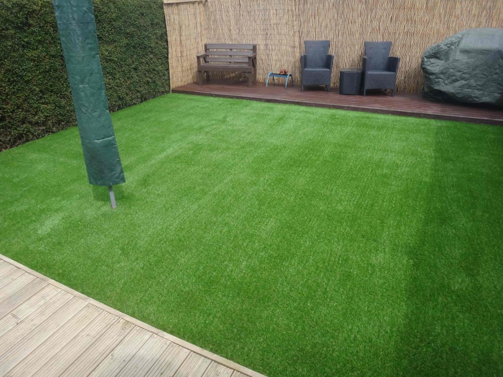 Small lawn of Artificial Grass created by Acre Driveways