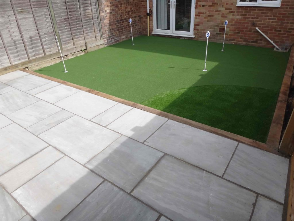 Small garden created using artificial grass by Acre Driveways