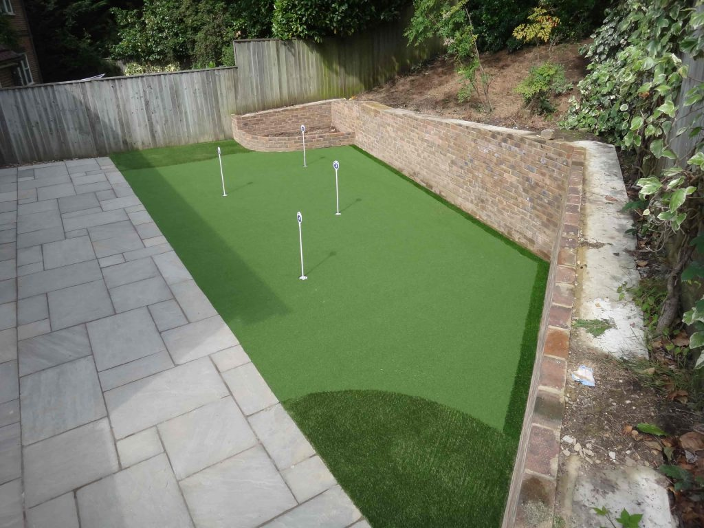 Artificial Grass lawn with freshly laid patio by Acre Driveways
