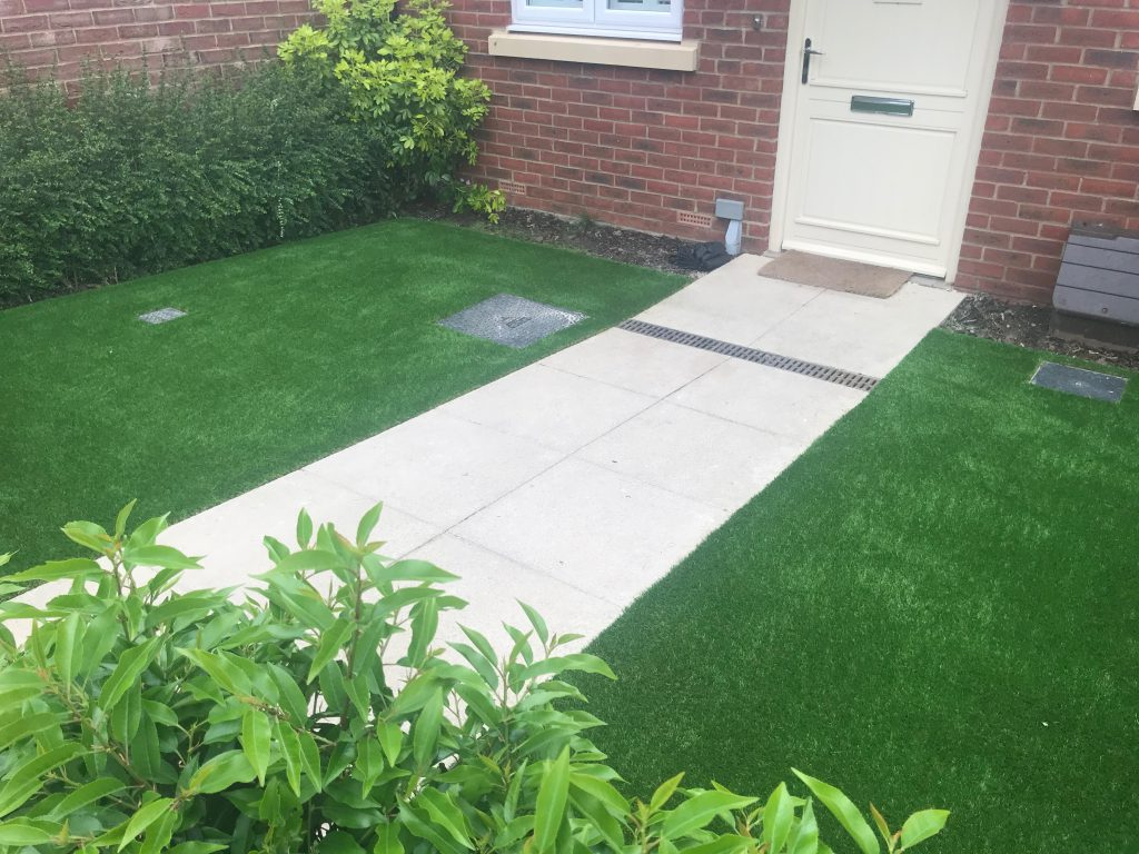 Artificial grass and paving installed by Acre Driveways