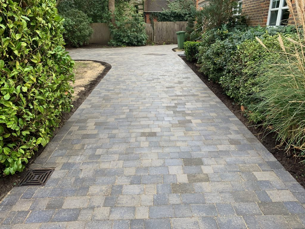 Pathway with grey and blue block paving by Acre Driveways