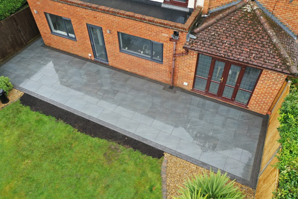 Slate coloured patio created by Acre Driveways