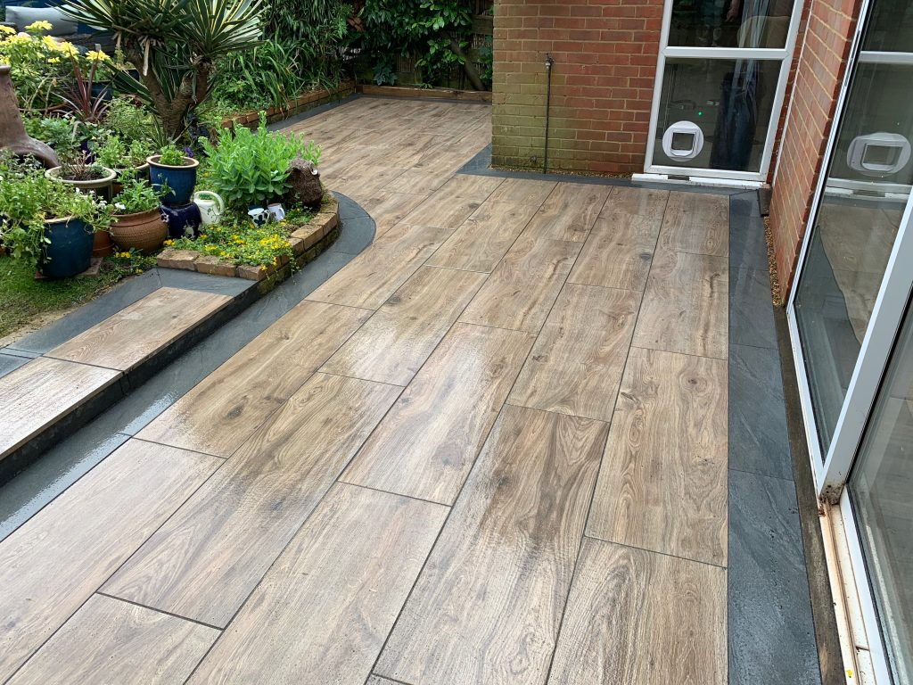 Wood effect patio by Acre Driveways