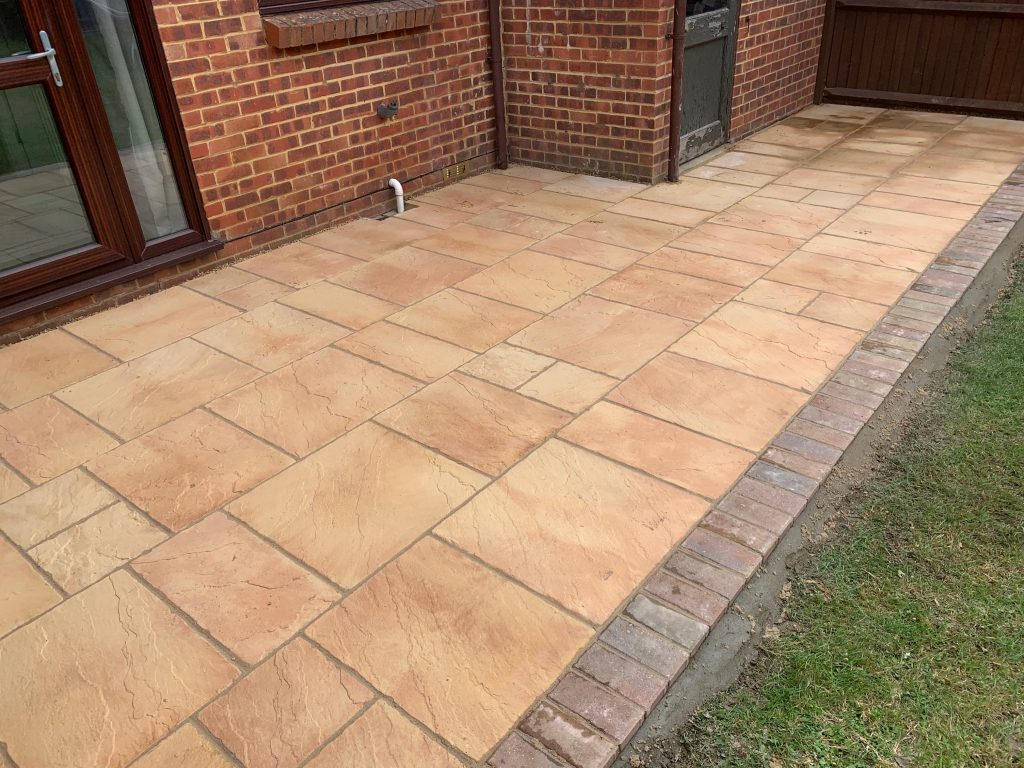 Beige Patio with brick lining by Acre Driveways