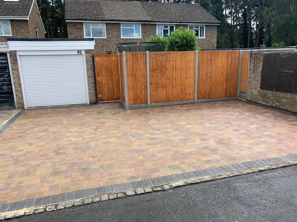 Multi coloured block paving for Garage by Acre Driveways