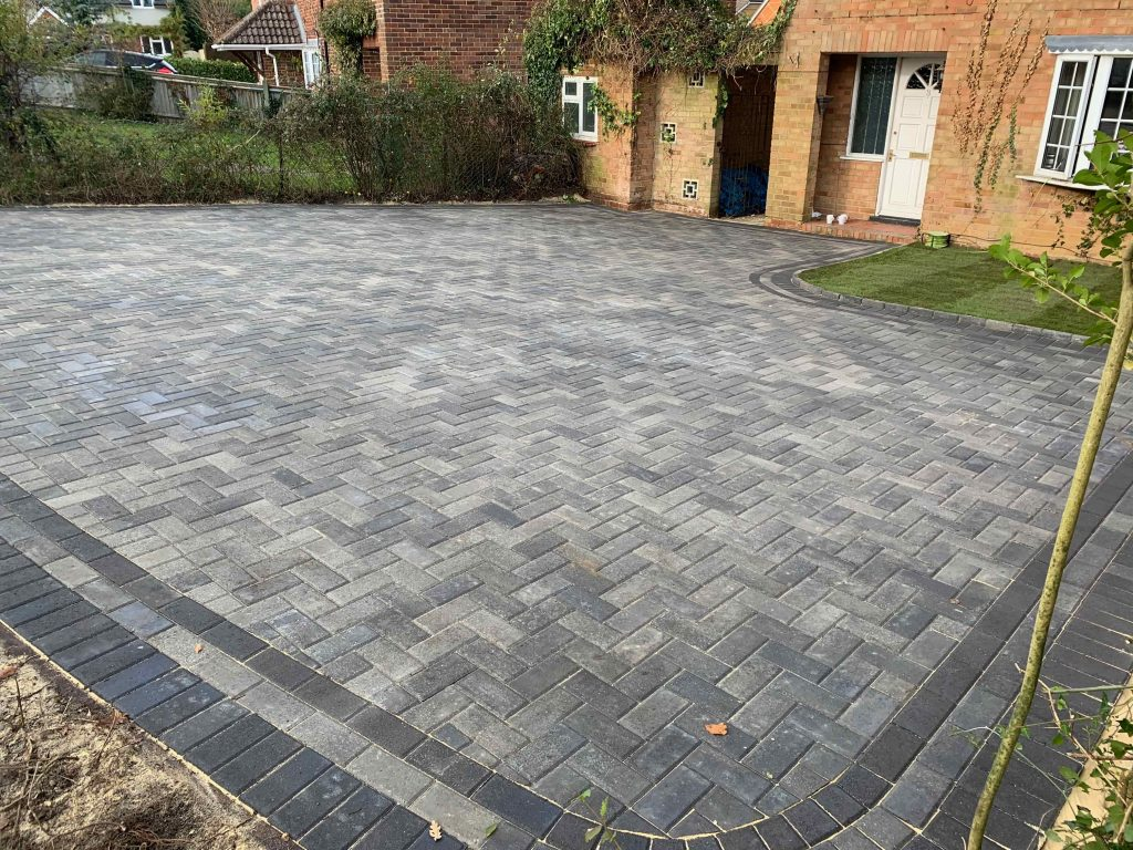 Grey block paving with round corners