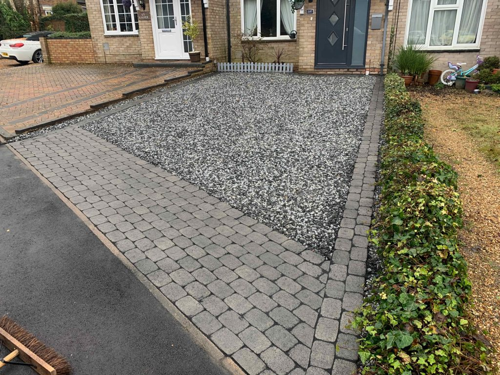 Grey block paving with gravel insert